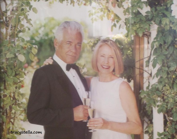 older couple under grape vine CAPTIONED